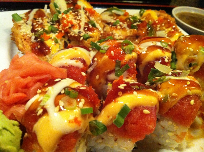 Spicy Girl roll: tempura talapia, cream cheese and avocado, topped with spicy tuna
