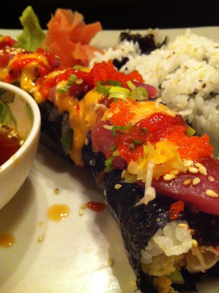 Sashimi Sunset roll: snow crab, cream cheese, daikon, lettuce, topped with tuna sashimi
