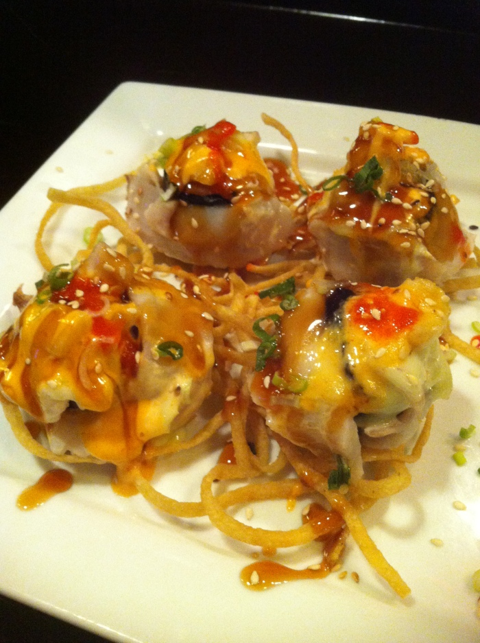 Sweety Yummy roll: krab, asparagus, cream cheese, wrapped in snapper, baked, topped with pineapple