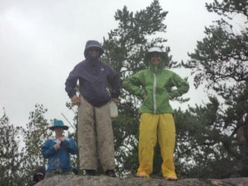 Mom and I in our rain gear up canoeing the Boundary Waters in Michigan